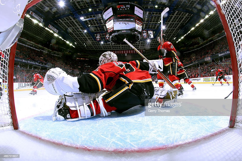 <a gi-track='captionPersonalityLinkClicked' href=/galleries/search?phrase=Karri+Ramo&family=editorial&specificpeople=716721 ng-click='$event.stopPropagation()'>Karri Ramo</a> #31 of the Calgary Flames stretches across the crease to make a save against the Los Angeles Kings at Scotiabank Saddledome on April 9, 2014 in Calgary, Alberta, Canada.