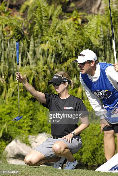 Karrie Webb lines up a putt with her caddie during the third round of the ADT Championship at the Trump International Golf Club in West Palm Beach...