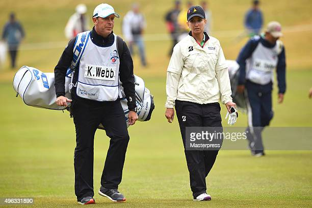 Karrie Webb of Australia and her caddie Mike Patterson looks on during the third round of the TOTO Japan Classics 2015 at the Kintetsu Kashikojima...