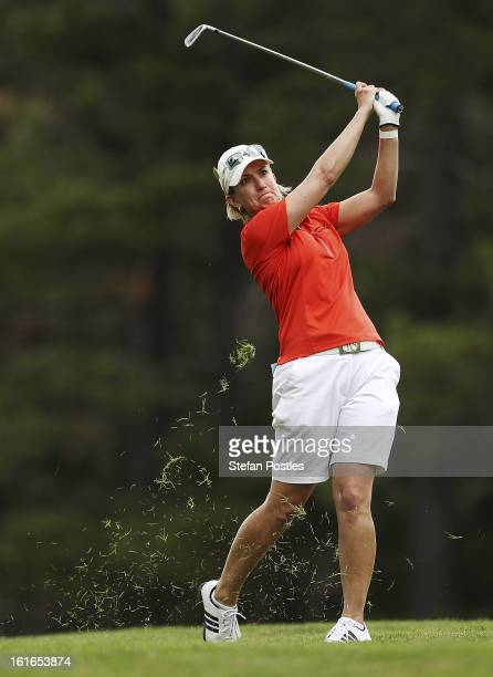 Karrie Webb of Australia hits off the fairway during day one of the ISPS Handa Australian Open at Royal Canberra Golf Club on February 14 2013 in...