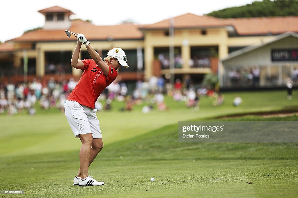 <a gi-track='captionPersonalityLinkClicked' href=/galleries/search?phrase=Karrie+Webb&family=editorial&specificpeople=202163 ng-click='$event.stopPropagation()'>Karrie Webb</a> of Australia hits to the 18th green during day one of the ISPS Handa Australian Open at Royal Canberra Golf Club on February 14, 2013 in Canberra, Australia.