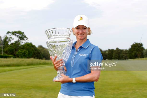 Karrie Webb of Australia holds the championship trophy after winning the ShopRite LPGA Classic Presented by Acer at Stockton Seaview Hotel and Golf...