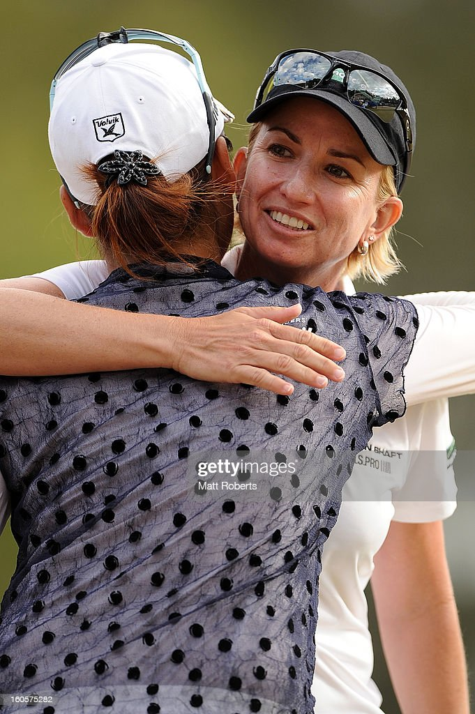 <a gi-track='captionPersonalityLinkClicked' href=/galleries/search?phrase=Karrie+Webb&family=editorial&specificpeople=202163 ng-click='$event.stopPropagation()'>Karrie Webb</a> of Australia hugs Chella Choi of Korea after winning the Australian Ladies Masters at Royal Pines Resort on February 3, 2013 on the Gold Coast, Australia.