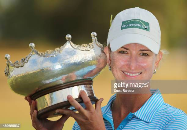 Karrie Webb of Australia kisses the trophy after winning the tournament during the fourth round of the ISPS Handa Women's Australian Open at The...