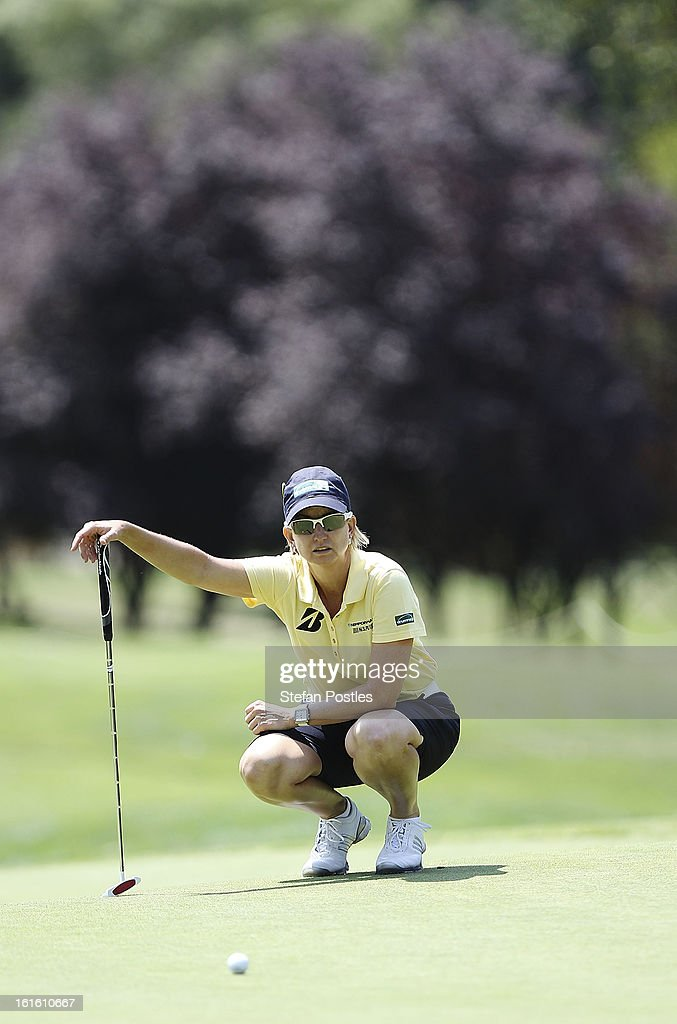 <a gi-track='captionPersonalityLinkClicked' href=/galleries/search?phrase=Karrie+Webb&family=editorial&specificpeople=202163 ng-click='$event.stopPropagation()'>Karrie Webb</a> of Australia lines up a putt during practice ahead of the ISPS Handa Australian Open at Royal Canberra Golf Club on February 13, 2013 in Canberra, Australia.