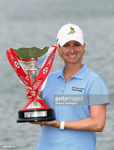 Karrie Webb of Australia poses with the trophy after winning the HSBC Women's Champions at the Tanah Merah Country Club on February 27 2011 in...
