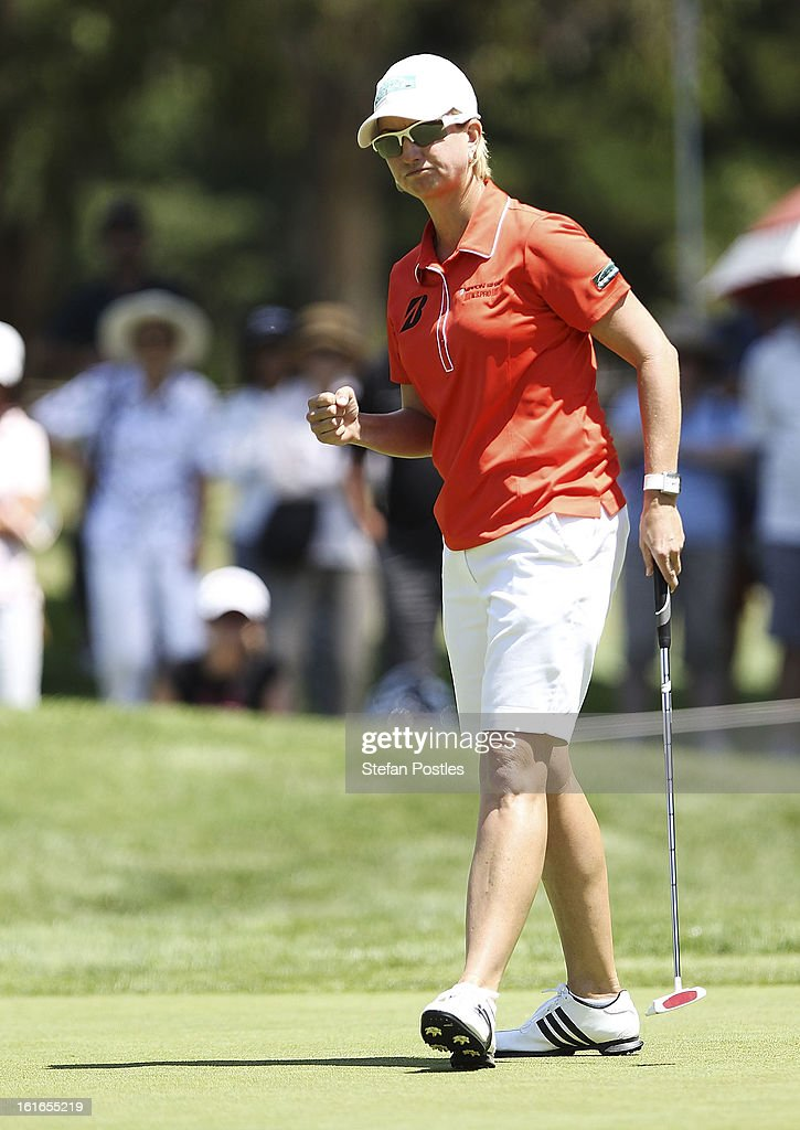 <a gi-track='captionPersonalityLinkClicked' href=/galleries/search?phrase=Karrie+Webb&family=editorial&specificpeople=202163 ng-click='$event.stopPropagation()'>Karrie Webb</a> of Australia reacts to sinking a putt during day one of the ISPS Handa Australian Open at Royal Canberra Golf Club on February 14, 2013 in Canberra, Australia.