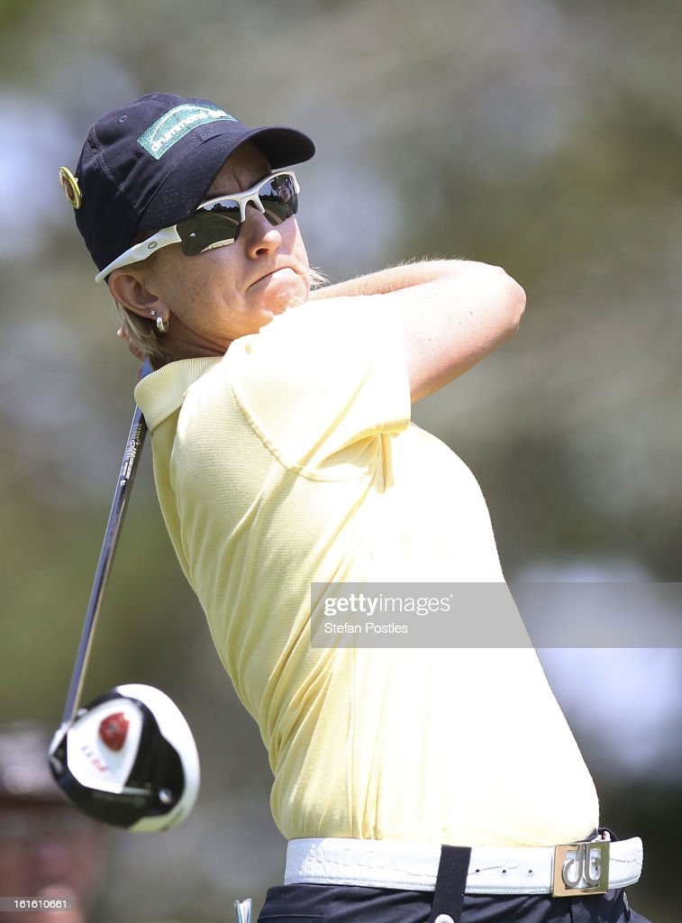 <a gi-track='captionPersonalityLinkClicked' href=/galleries/search?phrase=Karrie+Webb&family=editorial&specificpeople=202163 ng-click='$event.stopPropagation()'>Karrie Webb</a> of Australia tee's off during practice ahead of the ISPS Handa Australian Open at Royal Canberra Golf Club on February 13, 2013 in Canberra, Australia.