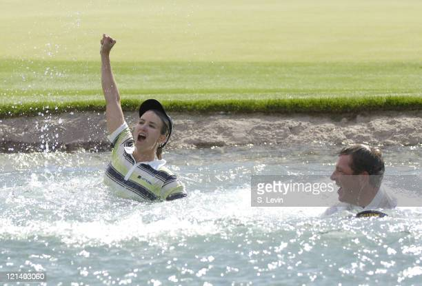 Karrie Webb winner of the Kraft Nabisco Championship takes the traditional dip into Poppy's Pond at The Mission Hills Country Club in Rancho Mirage...