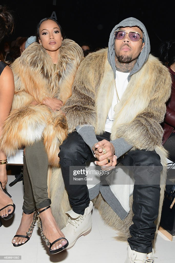 Karrueche Tran and Chris Brown attend the Michael Costello fashion show during MercedesBenz Fashion Week Fall 2015 at The Salon at Lincoln Center on...