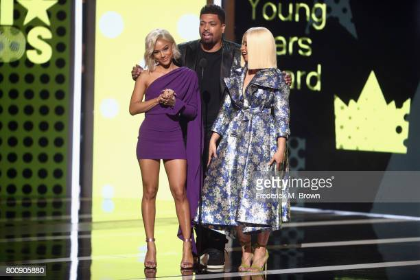 Karrueche Tran DeRay Davis and Cardi B speak onstage at 2017 BET Awards at Microsoft Theater on June 25 2017 in Los Angeles California