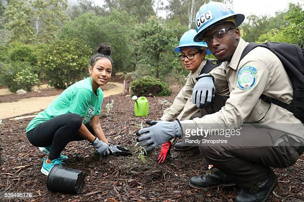 Karrueche Tran with volunteers Leticia Cabrera and Davion Evans attend Sierra Club National Parks Conservation Assoc EMA 'Give Back Day' to celebrate...