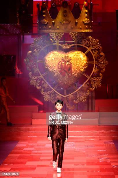 Karry Wang JunKai presents a creation for fashion house Dolce Gabbana during the Men's Spring/Summer 2018 fashion shows in Milan on June 17 2017 /...