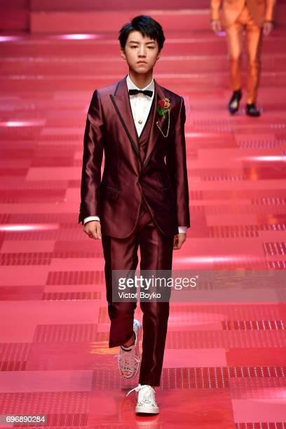 Karry Wang JunKai walks the runway at the Dolce Gabbana show during Milan Men's Fashion Week Spring/Summer 2018 on June 17 2017 in Milan Italy