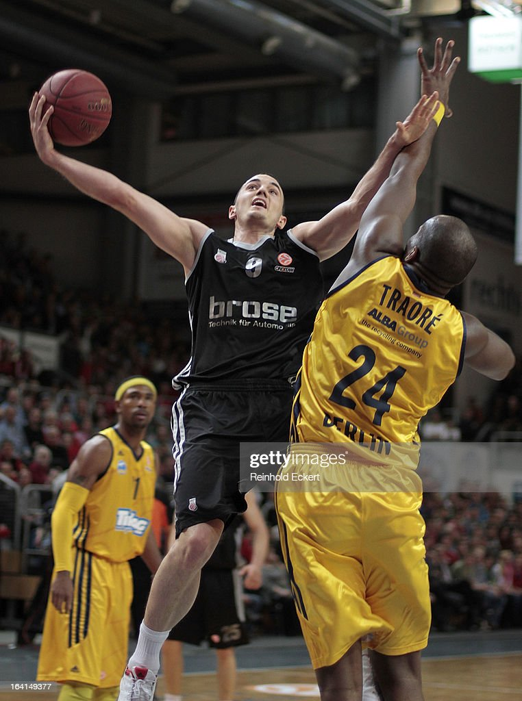 Karsten Tadda, #9 of Brose Baskets Bamberg competes with <a gi-track='captionPersonalityLinkClicked' href=/galleries/search?phrase=Ali+Traore&family=editorial&specificpeople=812387 ng-click='$event.stopPropagation()'>Ali Traore</a>, #24 of Alba Berlin during the 2012-2013 Turkish Airlines Euroleague Top 16 Date 12 between Brose Baskets Bamberg v Alba Berlin at Stechert Arena on March 20, 2013 in Bamberg, Germany.
