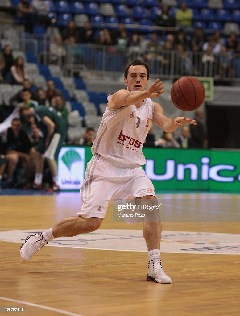 Karsten Tadda, #9 of Brose Baskets Bamberg in action during the 2012-2013 Turkish Airlines Euroleague Top 16 Date 1 between Unicaja Malaga v Brose Baskets Bamberg at Palacio Deportes Martin Carpena on December 27, 2012 in Malaga, Spain.
