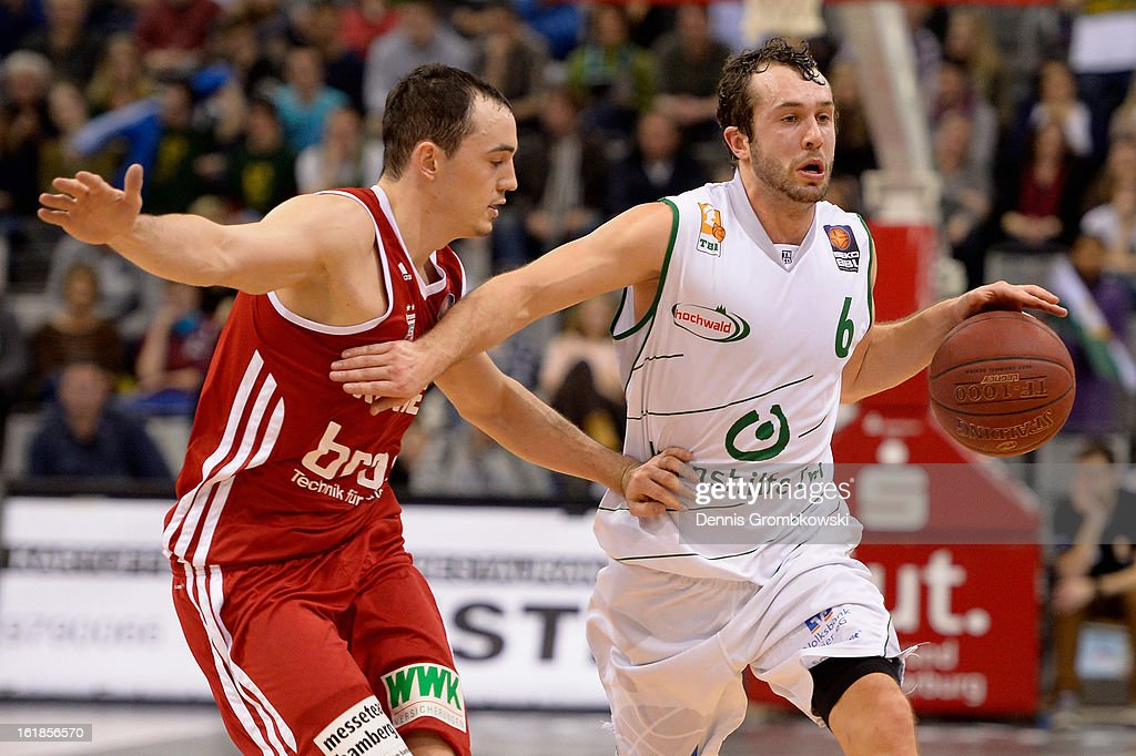 Karsten Tadda of Brose Baskets challenges Bastian Doreth of Trier during the Beko BBL Basketball Bundesliga match between TBB Trier and Brose Baskets on February 17, 2013 in Trier, Germany.