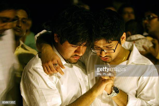 Karun and Nakul Agarwal grieve the loss of their parents Sanjay and Rita Agarwal who were killed in a militant attack during a candle light vigil...