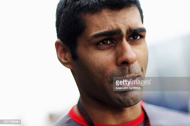 Karun Chandhok of India and Hispania Racing Team talks to the media in the paddock during previews to the British Formula One Grand Prix at...