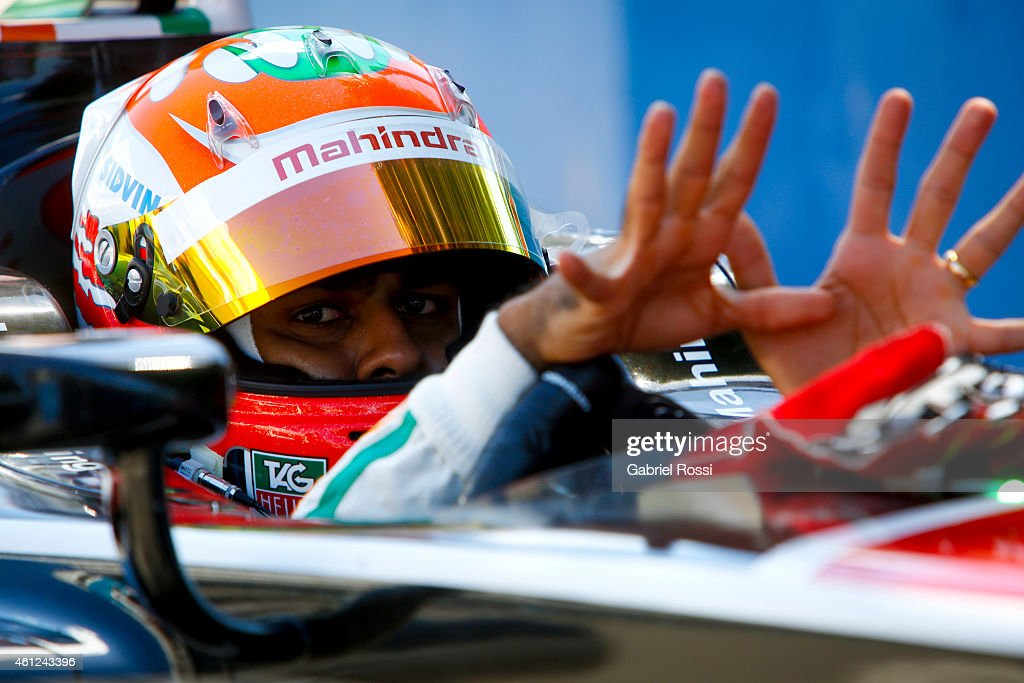 <a gi-track='captionPersonalityLinkClicked' href=/galleries/search?phrase=Karun+Chandhok&family=editorial&specificpeople=653120 ng-click='$event.stopPropagation()'>Karun Chandhok</a> of India and Mahindra Racing Formula E Team is seen on his car while waiting for the second lap during the Formula E Cars Complete Shakedown as part of 2015 FIA Formula E Buenos ePrix at Puerto Madero Street Race Track on January 09, 2015.