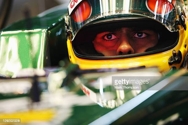 Karun Chandhok of India and Team Lotus prepares to drive during practice for the Korean Formula One Grand Prix at the Korea International Circuit on...
