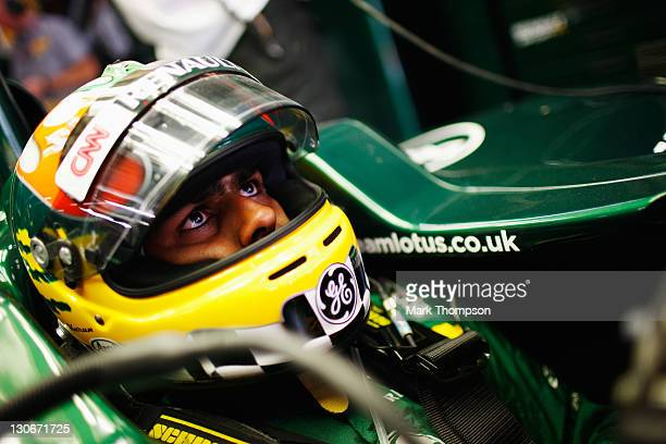 Karun Chandhok of India and Team Lotus prepares to drive during practice for the Indian Formula One Grand Prix at the Buddh International Circuit on...