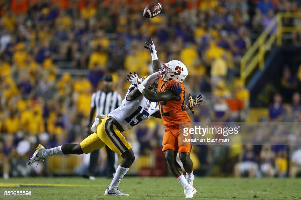 Kary Vincent Jr #15 of the LSU Tigers breaks up a pass intended for Nykeim Johnson of the Syracuse Orange during the second half of a game at Tiger...
