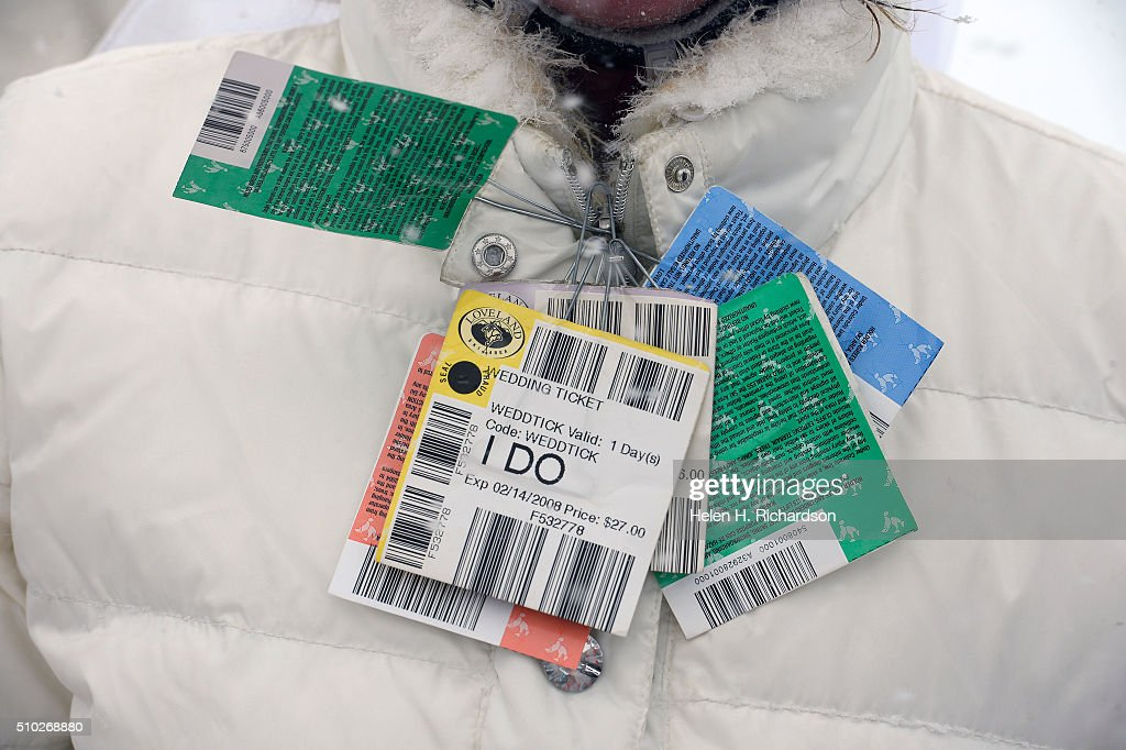 Karyn Brown has all of the lift tickets from the 6 years she has come with husband Tucker to renew their vows at the 25th annual Mountaintop Matrimony Valentine's day wedding ceremony on February 14, 2016 at the Loveland Ski area near Georgetown, Colorado. The couple got married here in 2007. The ceremony was held at Ptarmigan Roost cabin at the top of Ptarmigan lift. Approximately 100 couples got married or renewed their vows with minister Harry Heilmann, of the Universal Life Church, overseeing the ceremony.
