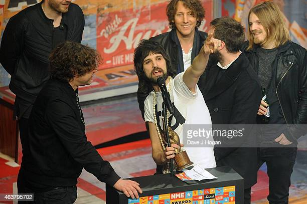 Kasabian receive the Best Album Award for '4813' at the NME Awards at Brixton Academy on February 18 2015 in London England