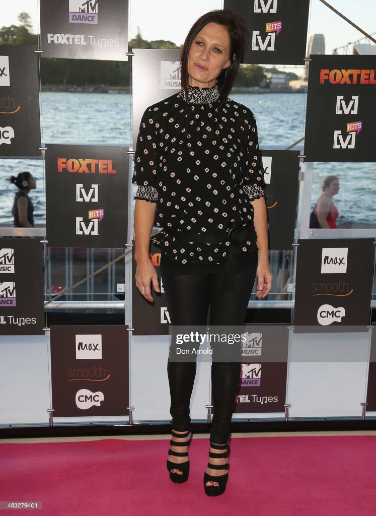 <a gi-track='captionPersonalityLinkClicked' href=/galleries/search?phrase=Kasey+Chambers&family=editorial&specificpeople=203119 ng-click='$event.stopPropagation()'>Kasey Chambers</a> arrives at the Foxtel Music Channels Summer Launch at the Botanic Gardens on December 3, 2013 in Sydney, Australia.