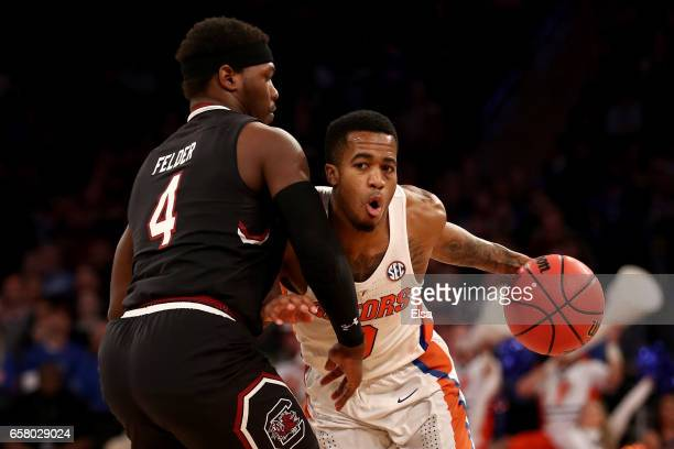 Kasey Hill of the Florida Gators drives to the basket against Rakym Felder of the South Carolina Gamecocks in the first half during the 2017 NCAA...