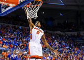 Kasey Hill of the Florida Gators dunks the ball during the first half of the game against the LSU Tigers at Stephen C O'Connell Center on January 9...