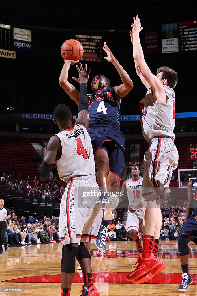 Kasey Hill #4 of the USA Junior Select Team shoots against Dennis Schroder #4 of the World Select Team during the 2013 Nike Hoop Summit game on April 20, 2013 at the Rose Garden Arena in Portland, Oregon.