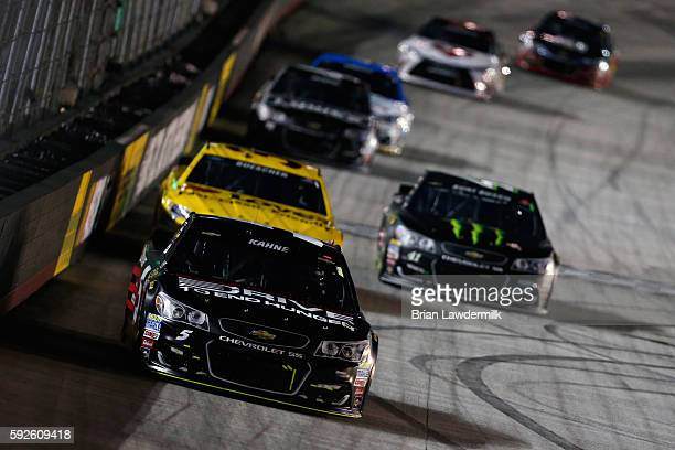 Kasey Kahne driver of the AARP Drive to End Hunger Chevrolet leads a pack of cars during the NASCAR Sprint Cup Series Bass Pro Shops NRA Night Race...