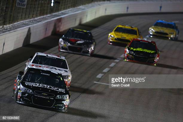Kasey Kahne driver of the AARP Drive to End Hunger Chevrolet leads a pack of cars during the NASCAR Sprint Cup Series AAA Texas 500 at Texas Motor...