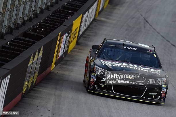 Kasey Kahne driver of the AARP Drive to End Hunger Chevrolet races during qualifying for the NASCAR Sprint Cup Series Bass Pro Shops NRA Night Race...