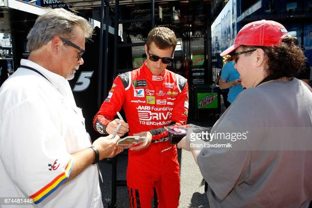 Kasey Kahne driver of the AARP Drive to End Hunger Chevrolet signs autographs for fans during practice for the Monster Energy NASCAR Cup Series...