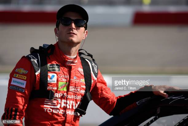 Kasey Kahne driver of the AARP Drive to End Hunger Chevrolet stands on the grid during qualifying for the Monster Energy NASCAR Cup Series Toyota...