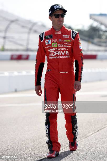 Kasey Kahne driver of the AARP Drive to End Hunger Chevrolet walks down the grid during qualifying for the Monster Energy NASCAR Cup Series Toyota...
