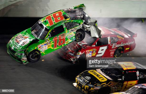 Kasey Kahne driver of the Budweiser Dodge crashes into the rear of Kyle Busch driver of the Interstate Batteries Toyota after Kyle hit the wall on...