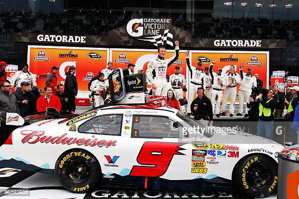 Kasey Kahne driver of the Budweiser Ford celebrates in victory lane after winning the second NASCAR Sprint Cup Series Gatorade Duel at Daytona...