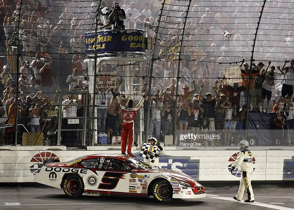 Kasey Kahne driver of the Dodge Dealers Dodge gets the checkered flag after winning the NASCAR Nextel Cup Series CocaCola 600 on May 28 2006 at...