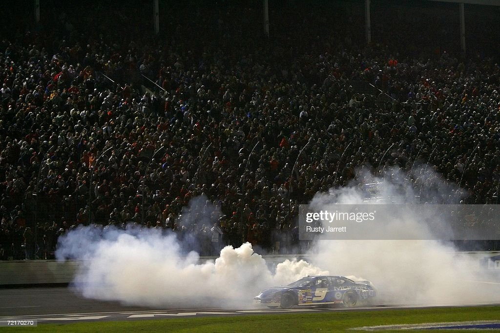 Kasey Kahne driver of the Dodge Dealers/UAW Dodge celebrates his win with a burnout following the NASCAR Nextel Cup Series Bank of America 500 on...