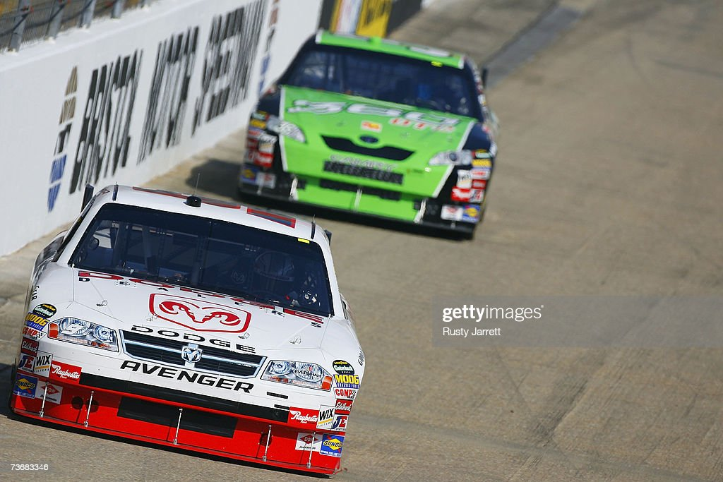 Kasey Kahne driver of the Dodge Dealer/UAW Dodge leads Jeremy Mayfield driver of the 360 OTC Toyota during practice for the NASCAR Nextel Cup Series...