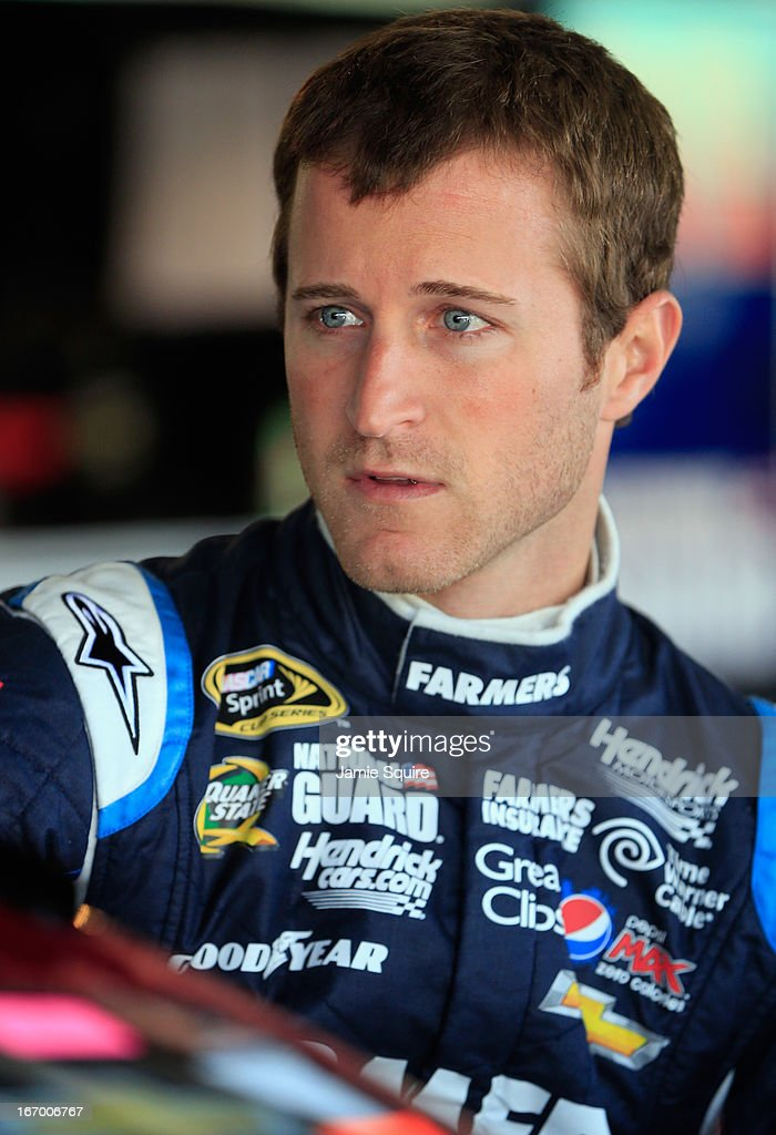 <a gi-track='captionPersonalityLinkClicked' href=/galleries/search?phrase=Kasey+Kahne&family=editorial&specificpeople=183374 ng-click='$event.stopPropagation()'>Kasey Kahne</a>, driver of the #5 Farmers Insurance 85th Anniversary Chevrolet, stands in the garage area during practice for the NASCAR Sprint Cup Series STP 400 at Kansas Speedway on April 19, 2013 in Kansas City, Kansas.