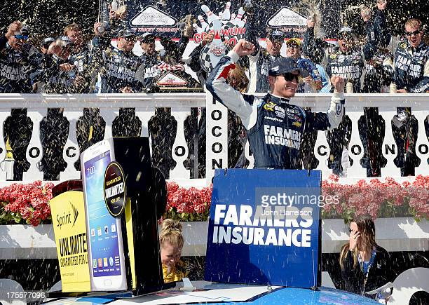 Kasey Kahne driver of the Farmers Insurance Chevrolet celebrates in victory lane after winning the NASCAR Sprint Cup Series GoBowlingcom 400 at...