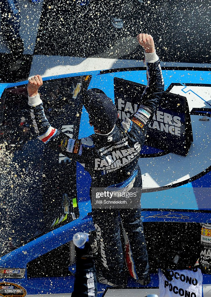 <a gi-track='captionPersonalityLinkClicked' href=/galleries/search?phrase=Kasey+Kahne&family=editorial&specificpeople=183374 ng-click='$event.stopPropagation()'>Kasey Kahne</a>, driver of the #5 Farmers Insurance Chevrolet, celebrates in victory lane after winning the NASCAR Sprint Cup Series GoBowling.com 400 at Pocono Raceway on August 4, 2013 in Long Pond, Pennsylvania.