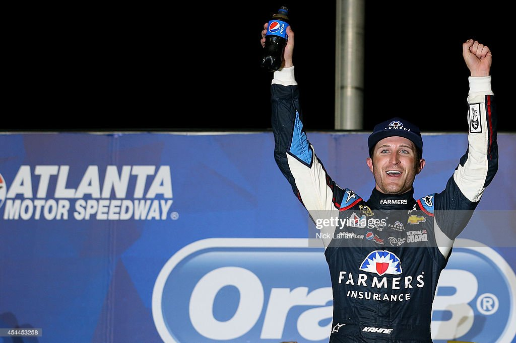 <a gi-track='captionPersonalityLinkClicked' href=/galleries/search?phrase=Kasey+Kahne&family=editorial&specificpeople=183374 ng-click='$event.stopPropagation()'>Kasey Kahne</a>, driver of the #5 Farmers Insurance Chevrolet, celebrates in Victory Lane after winning the NASCAR Sprint Cup Series Oral-B USA 500 at Atlanta Motor Speedway on August 31, 2014 in Hampton, Georgia.