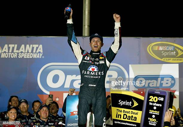 Kasey Kahne driver of the Farmers Insurance Chevrolet celebrates in Victory Lane after winning the NASCAR Sprint Cup Series OralB USA 500 at Atlanta...