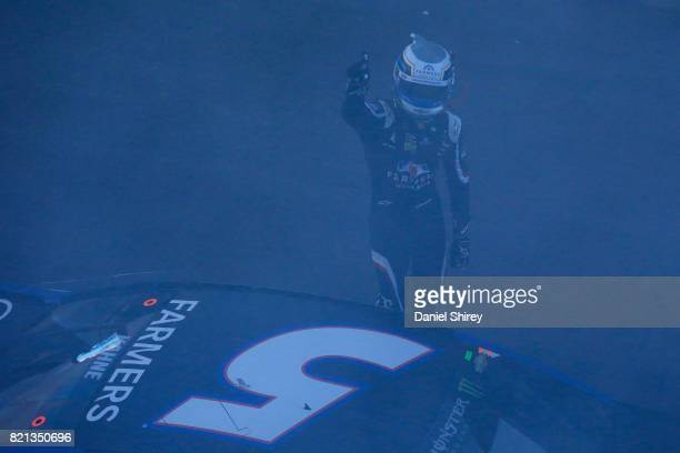 Kasey Kahne driver of the Farmers Insurance Chevrolet celebrates after winning the Monster Energy NASCAR Cup Series Brickyard 400 at Indianapolis...